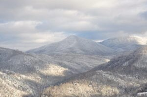 A scenic photograph of the Smoky Mountains covered in snow.