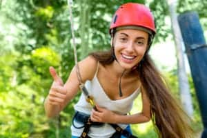 Young woman at a zipline course.
